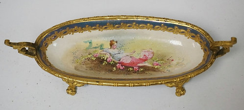 HAND PAINTED AND GILT BRONZE MOUNTED SEVRES PORCELAIN OVAL DISH. DECORATED WITH