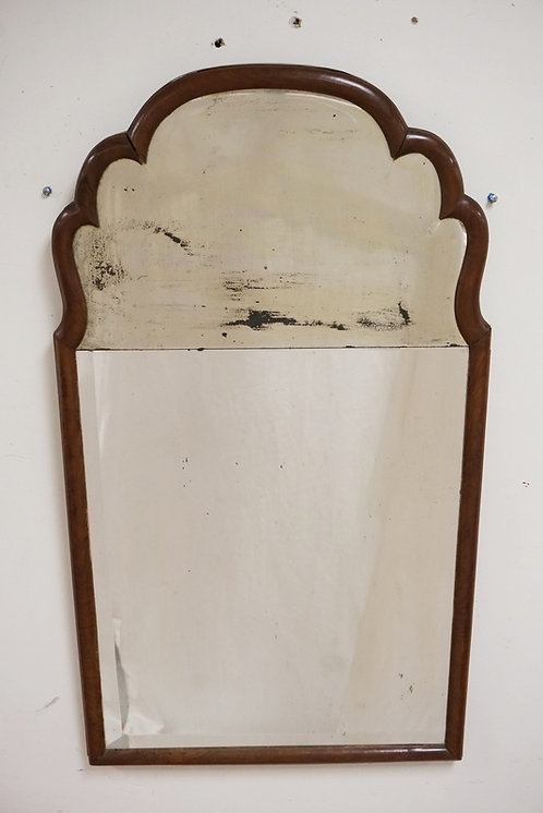 ANTIQUE QUEEN ANNE MIRROR WITH A SCALLOPED TOP AND BEVELED GLASS. 21 3/4 X 28 1/