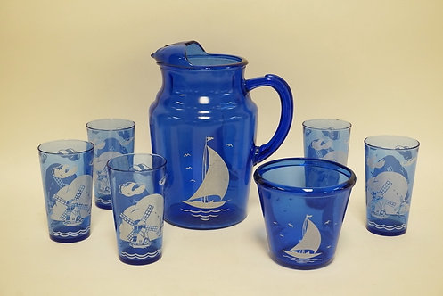 1206_8 PIECE COBALT BLUE GLASSWARE DECORATED WITH SAILBOATS AND WINDMILLS. PITCH