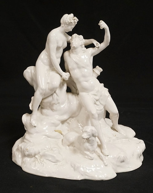 ANTIQUE PORCELAIN FIGURAL GROUP. 9 1/8 INCHES HIGH. TAIL OF DOG REPAIRED. LOSSES