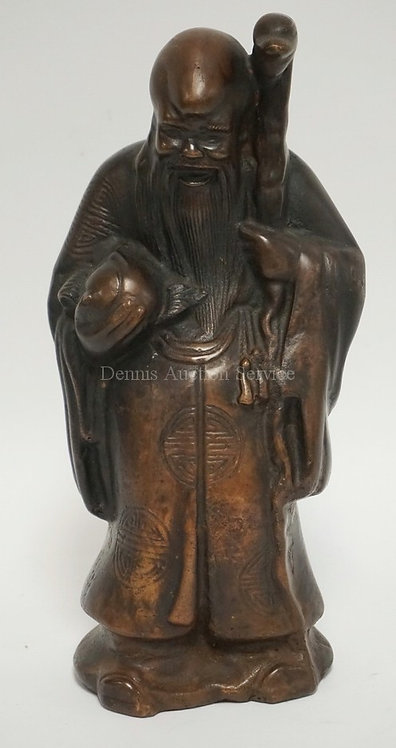 BRONZE FIGURE OF AN ASIAN MAN WITH A STAFF. 11 1/2 INCHES HIGH.