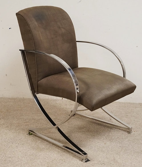 MODERN CHROME ARMCHAIR BY CENTURY FURNITURE. 38 INCHES HIGH. 25 1/2 INCHES WIDE.