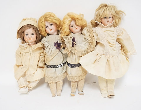 LOT OF 4 GERMAN BISQUE HEAD DOLLS. TALLEST MEASURES 15 INCHES.