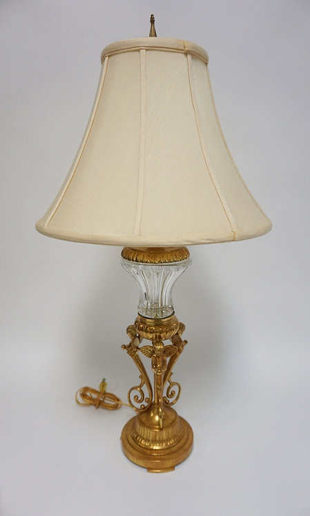 GILT METAL AND GLASS TABLE LAMP. THE METALWORK DEPICTING CHERUBS. MADE BY *BERMA