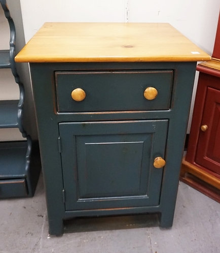COUNTRY STYLED CABINET. PINE WITH BLUE PAINT. 28 INCHES HIGH. 20 INCHES WIDE.