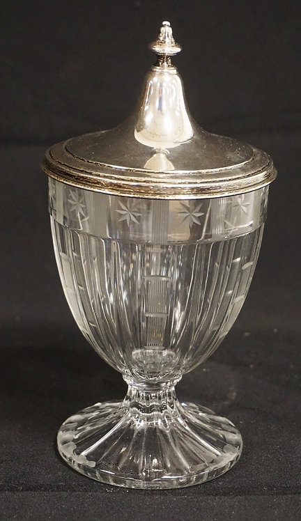 HEISEY GLASS JAR WITH A STERLING SILVER LID. 8 INCHES HIGH.