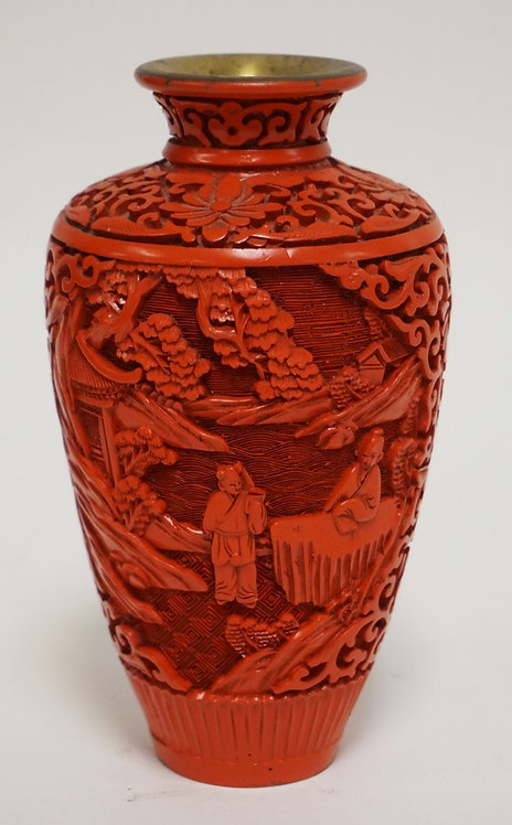 CARVED CINNABAR VASE MEASURING 6 1/2 INCHES HIGH.