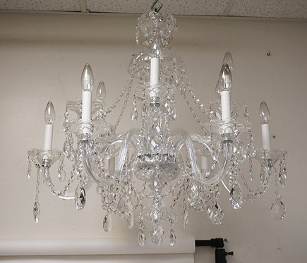 FINE CUT CRYSTAL CHANDELIER WITH 12 LIGHTS. ADORNED WITH CUT BEAD DRAPERY AND CU