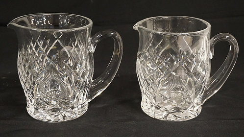 PAIR OF WATERFORD CUT CRYSTAL PITCHERS. 6 INCHES HIGH.