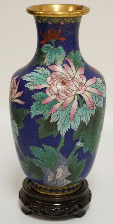 CLOISONNE VASE DECORATED WITH FLOWERS. STANDING ON A CARVED WOODEN BASE. 11 1/4