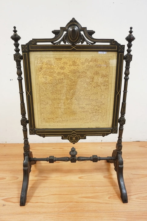 CARVED VICTORIAN FIRE SCREEN WITH A DECORATIVE PANEL CONSISTING OF A WOVEN ASIAN