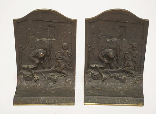 PAIR OF BRONZE *VILLAGE BLACKSMITH* BOOKENDS. 5 INCHES HIGH.