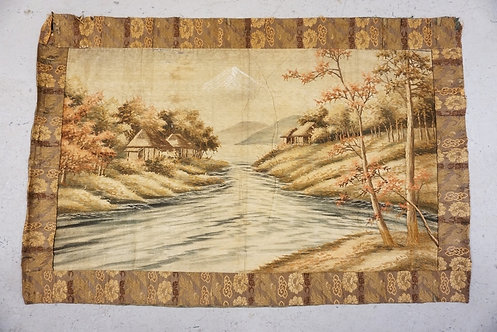 ANTIQUE HAND STITCHED TAPESTRY HAVING HUTS NEAR A WATERAY WITH MOUNTAINS IN THE