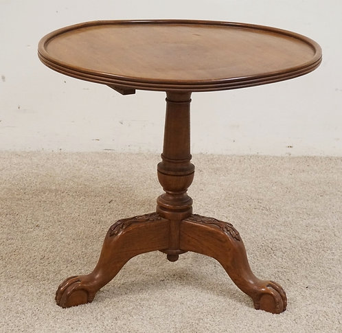 CARVED WALNUT TILT TOP TABLE WITH A DISH TOP. 23 1/2 INCHES HIGH. 22 INCHES WIDE