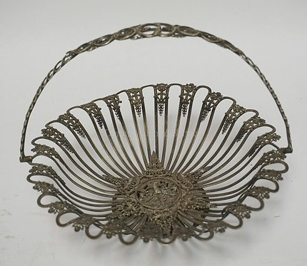 VERY ORNATE WHITE METAL OPENWORK BASKET WITH A CENTRAL MEDALLION DEPICTING CUPID