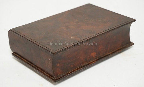 BURLED WOODEN BOOK FORM BOX MEASURING 6 3/4 X 4 3/4 X 2 1/8 INCHES.
