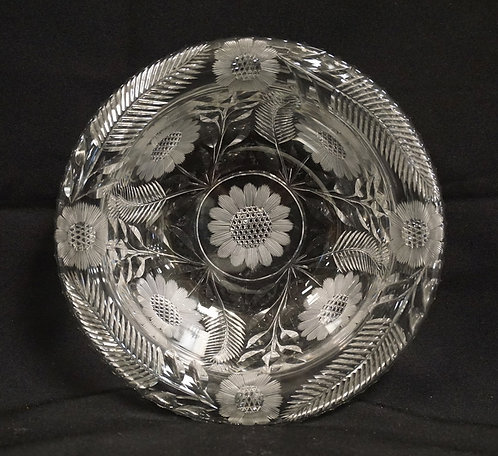 CUT GLASS BOWL WITH A LEAF AND FLOWER PATTERN. ROLLED RIM. 8 INCH DIA.