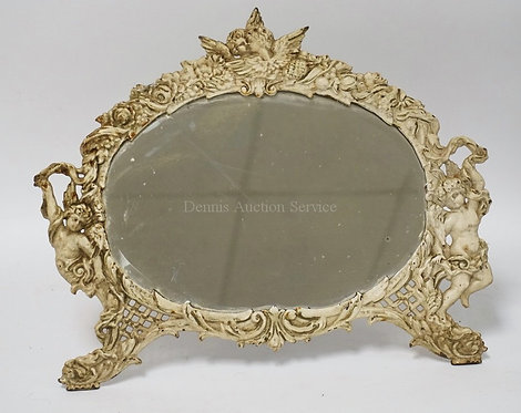 STANDING MIRROR WITH A CAT IRON FRAME WITH FIGURES OF CHERUBS. STAMPED NB&IW ON