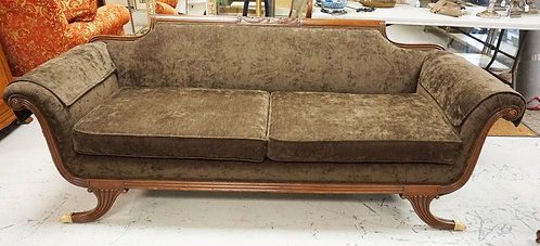CARVED MAHOGANY SOFA WITH BRASS CLAW FEET. 80 IN WIDE