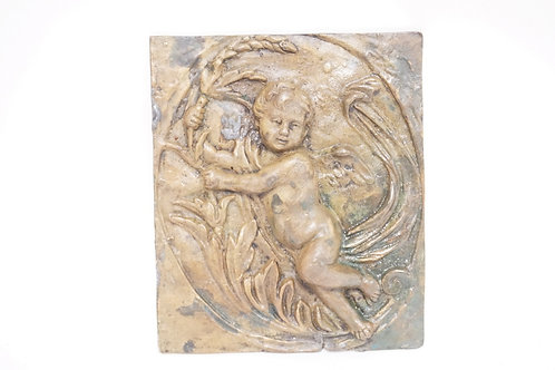 BRONZE PANEL WITH A DEEP RELIEF FIGURE OF A CHERUB. 7 3/4 X 9 INCHES.