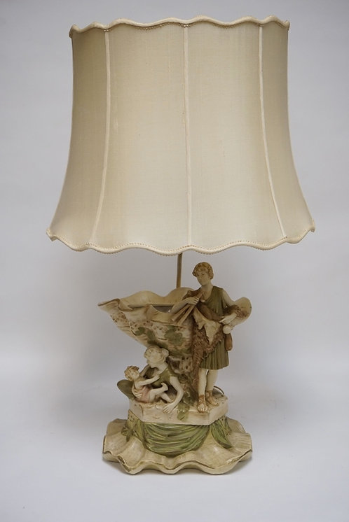 ROYAL DUX TABLE LAMP IN THE FORM OF A MAN WITH FLUTES AND A RECLINING WOMAN HOLD
