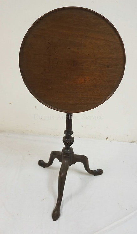 ANTIQUE WALNUT SNAKE FOOT CANDLESTAND WITH A TILTING DISH TOP. EARLY IRON BRACE