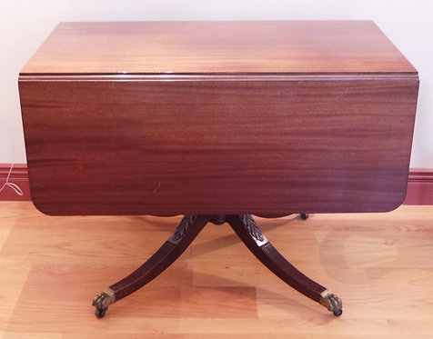 MAHOGANY DROPLEAF TABLE WITH BRASS PAW FEET. 42 X 24 INCH TOP. 29 INCHES HIGH.