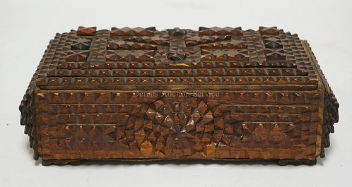 TRAMP ART CARVED WOODEN BOX. 10 X 6 1/4 AND 3 1/2 INCHES HIGH.