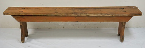 PRIMITIVE BENCH IN SALMON PAINT (WITH WEAR). 69 X 11 1/2 AND 16 INCHES HIGH.