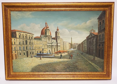OIL PAINTING ON CANVAS OF A COBBLESTONE CITY STREET LINED BY BUILDINGS. SIGNED L