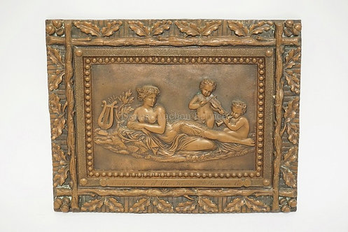 COPPER RELIEF PANEL DEPICTING A RECLINING CLASSICAL WOMAN WITH PUTI FIGURES PLAY