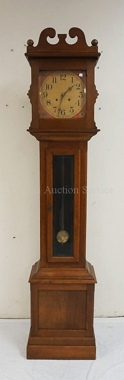 TALL CASE CLOCK MEASURING 85 INCHES HIGH AND 19 INCHES WIDE.