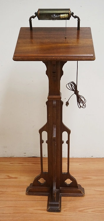 MAHOGANY LECTURN WITH AN OPENWORK BASE. 53 INCHES HIGH.