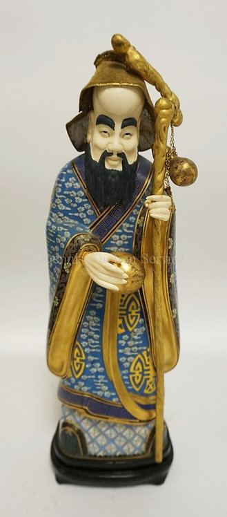 CLOISONNE FIGURE OF A BEARDED MAN HOLDING A STAFF. HIS HAT IS FINE BRASS MESH. M