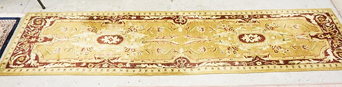 CONTEMPORARY ORIENTAL RUNNER MEASURING 10 FT 2 X 2 FT 3 INCHES.