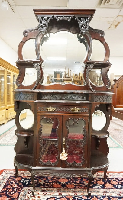 BEAUTIFULLY CARVED MAHOGANY ETEGERE WITH BEVELED GLASS MIRRORS. 76 1/2 INCHES HI