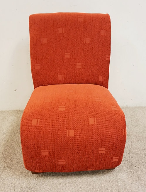 RED UPHOLSTERED CHAIR. 39 INCHES HIGH.