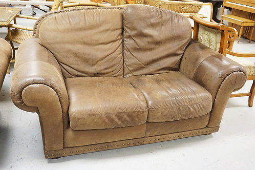BROWN LEATHER LOVESEAT.