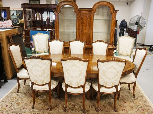 12 PIECE DINING ROOM SET. CONSISTS OF A TABLE WITH 3 LEAVES, 10 CHAIRS, AND A BR