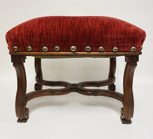 CARVED WALNUT FOOTSTOOL WITH AN UPHOLSTERED TOP.