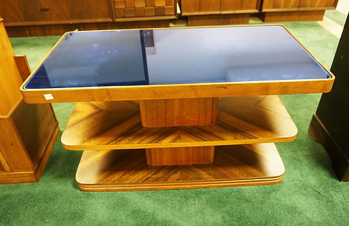 DECO COFFEE TABLE WITH A COBALT BLUE GLASS TOP. 32 1/2 X 16 1/2 INCH TOP. 18 INC