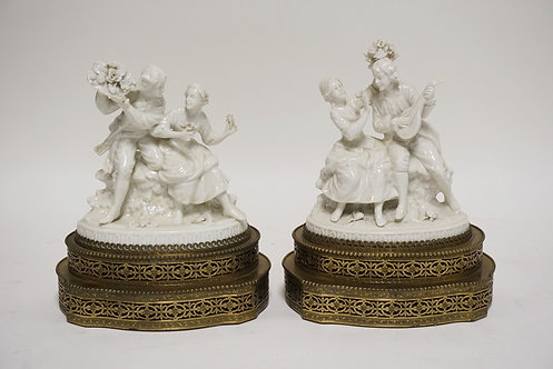 PAIR OF SITZEDORFER PORCELAIN FIGURAL LAMPS (MISSING FIXTURES AND WIRING). 9 1/4