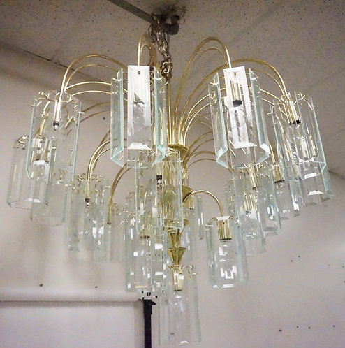 MID CENTURY MODERN CHANDELIER. BRASS WITH CUT GLASS PRISM PANELS. APPROX 37 INCH