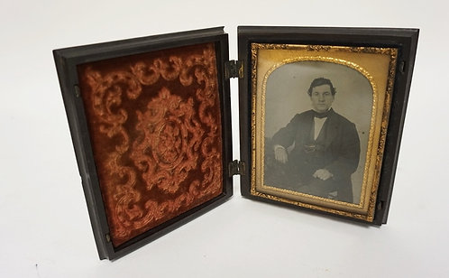 LARGE HARD CASED IMAGE OF A GENTLEMAN. 2 SMALL CHIPS ON EDGES.4 1/8 IN X 5IN OVE