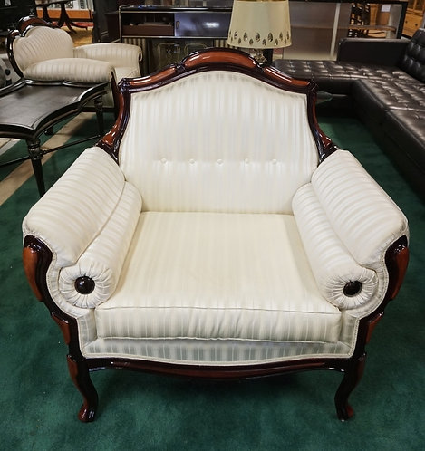 UPHOLSTERED ARMCHAIR.