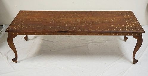 WALNUT COFFEE TABLE WITH INTRICATE BRASS INLAY. THE TOP IS A SOLID SINGLE BOARD