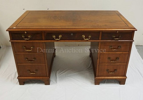 MAHOGANY DESK WITH A . BOOK MATCHED FIGURED VENEER AND BANDED TOP. 54 X 30 INCH