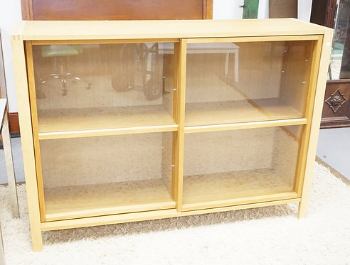 MODERN CABINET WITH SLIDING GLASS DOORS. 63 IN WIDE, 45 1/2 IN H, 17 IN DEEP