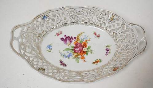 SCHUMANN DRESDEN RETICULATED BOWL DECORATED WITH FLOWERS. 11 3/4 X 7 1/2 INCHES.