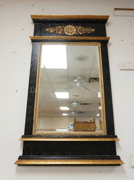 WALL MIRROR IN A BLACK AND GOLD DECORATED FRAME. 36 X 60 INCHES